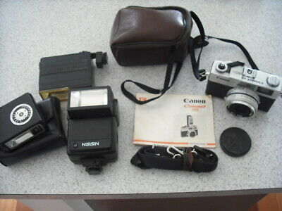 Vintage Canon Camera And Various Flashes Nissin Soltron & Argus Some With Cases