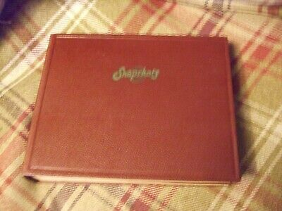 "Handsome red Vintage 25 page ""Snapshots"" Album space for 200 3"" x 2"" photographs"