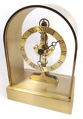 Beautiful vintage brass German Bucherer skeleton mantel clock