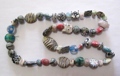 A String Beautiful Peking Colored Glass Carved animal Necklace Beads 14""