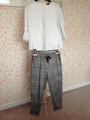 girls age 9 m&s blouse and next checked trousers great condition