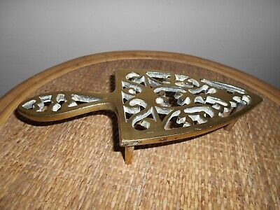 An Antique Fretted Brass Trivet. A Victorian Fretted Brass Smoothing Iron Stand