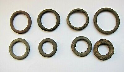 lot of 8 Celtic bronze ring-money, 5th-1st cent BC.
