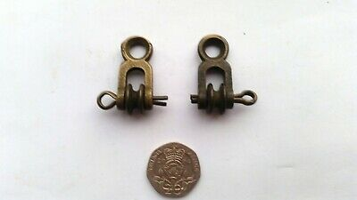 a scarce matching pair of antique original grandfather clock of weight pulleys.