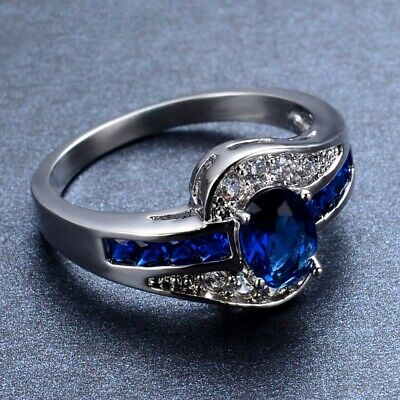 Beautiful 1.0 ct. Oval Simulated Blue Sapphire Ring Channel Set With Clear CZ Ac