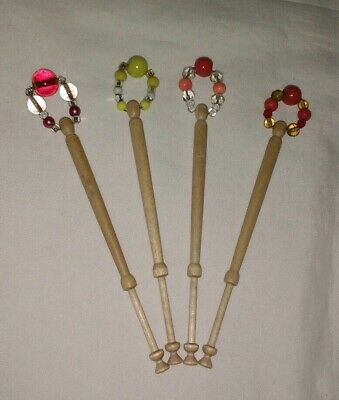 4 Light Wooden Lace Bobbins With Spangles.