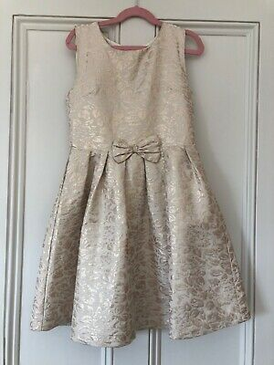 Beautiful lined gold dress from John Lewis age 10