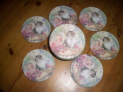 cats coasters in a tin