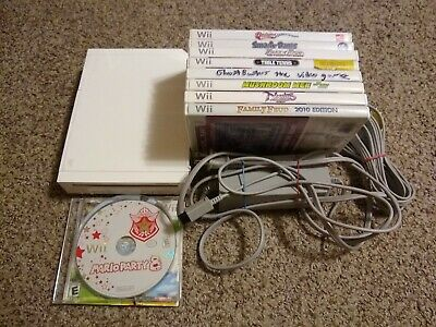 Nintendo Wii White Console (NTSC) with 11 games and power/av cables. Read descri
