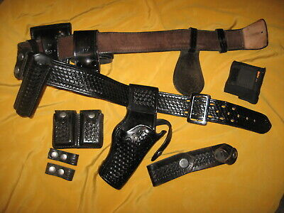 Police/security holster by Tex Shoemaker & Son, With belt and 6 accessories.