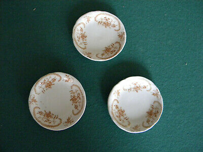Three Antique Brown and White Transferware Butter Pats