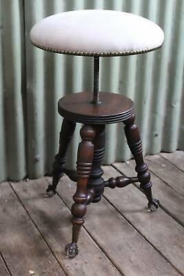 An Antique Swivel Piano Stool on Brass Claw with Glass Ball Feet