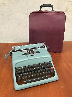 VINTAGE OLIVETTI STUDIO 44 PORTABLE TYPEWRITER w CASE WORKING Shop Display ITALY