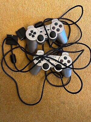 2 X Faulty Official Silver ps2 game controllers Spare Or Repair