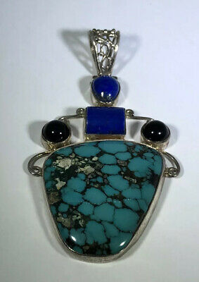 "Sterling Silver Deluxe 31/2"" Sodalite, Garnet And Turquoise Aggregate Pendant."