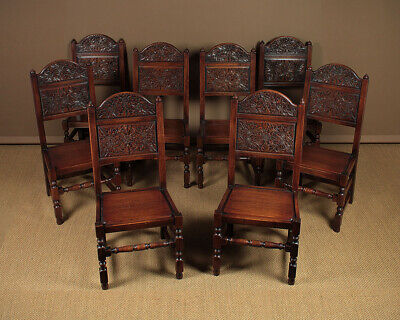 Set of Eight 17th.c. Style Carved Oak Dining Chairs.