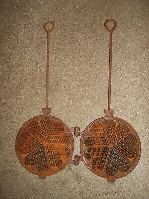 An Antique French Long Handled Heavy Cast Iron Heart Shaped Waffle Press