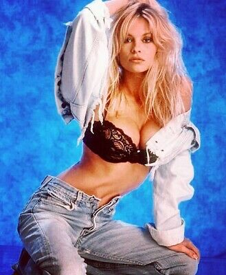 Pam Anderson - In Jeans And A Bra Posing !!!