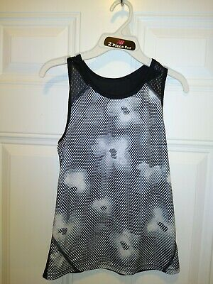 Kids Daniskin Now Semi Fitted Active Tank. Color is black and white. Size M(7-8)