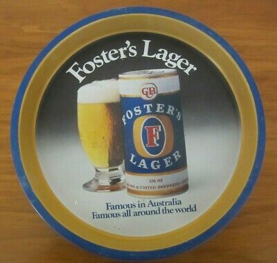 """ROUND """"FOSTERS LAGER"""" DRINKS TRAY - 31 cm DIAMETER - 3 cm DEEP - USED"""