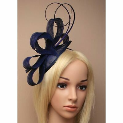 Navy sinamay cap fascinator with loops and quills on an aliceband.