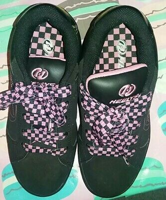 Girls pink/black heelys trainers size 4