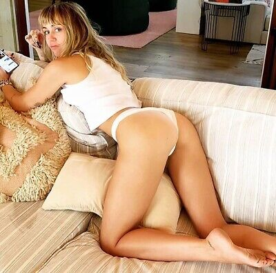 MILEY CYRUS - WITH THONG PANTIES ON - Bending Over Her Couch !!