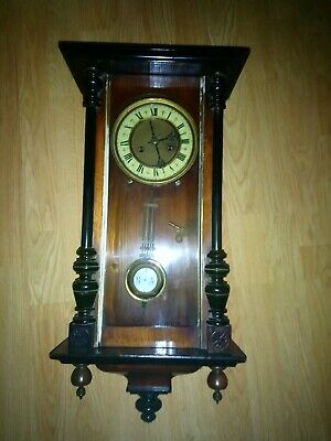 Antique wind up wall clock with key