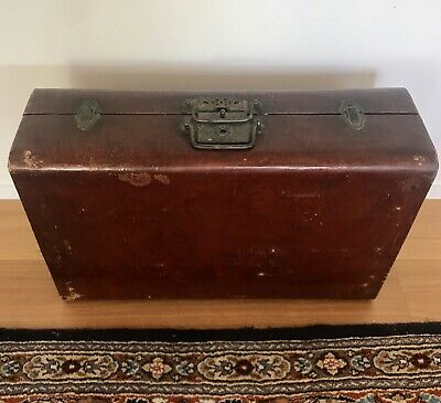 Antique Chinese Suitcase of red lacquered wood and goatskin leather.