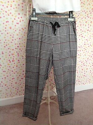 girls age 9 checked trousers with sporty stripe NEXT VGC
