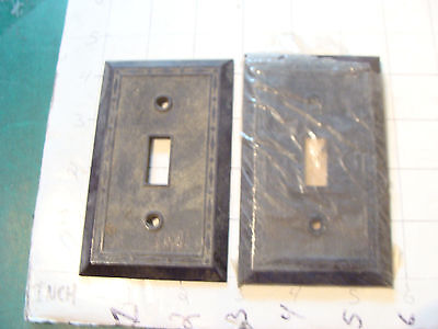 vintage INDUSTRIAL group of 2 LEVITON switch covers, one in plastic still