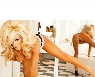 Jenny Mccarthy - Bending Over With Thong Panties On And There Is A Mirror There