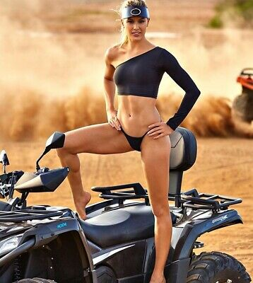 Genie Bouchard - Not Wearing Too Much On Top Of This Three Wheeler !!