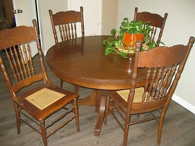 4-Antique Pressed High Back Dinning Chairs with Cane Seats and Hardwood Table