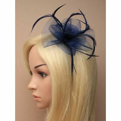Navy blue fascinator with flower and feathers on aliceband.