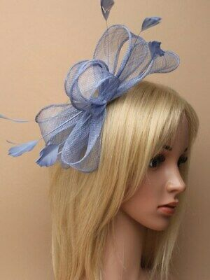Blue fascinator with bows and feather tendrils on clear comb.
