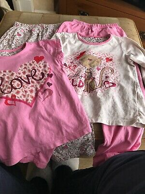 2 Pairs Of Girls Pyjamas Aged 6-7 Years