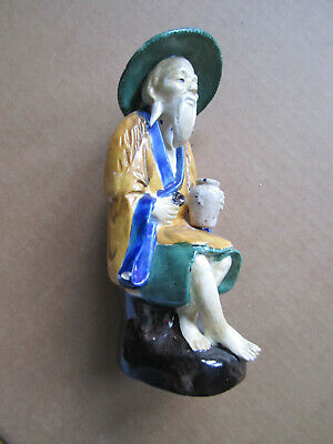 Figurine of bearded Chinese man holding a pot