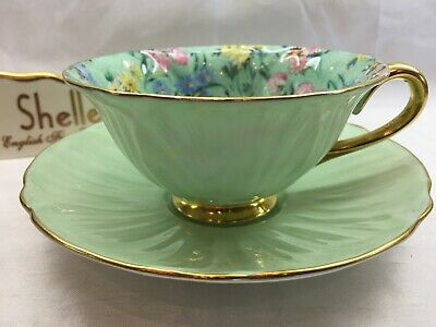 Shelley MELODY CHINTZ  FOOTED OLEANDER  CUP AND  SAUCER  -  GOLD TRIM