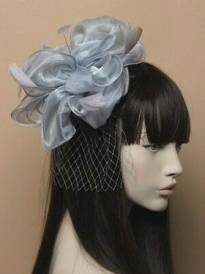 Grey chiffon fascinator with net and feathers on aliceband.
