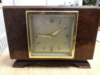 Vintage Elliott Mantle Clock. Ticks when wound and seems to keep time.