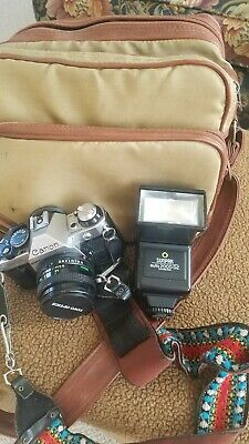 Canon AE-1 Program 35mm SLR Film Camera with 50 mm lens Kit with extended flash