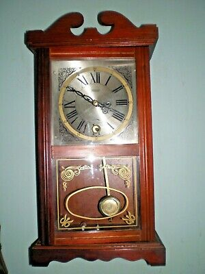 Vintage Mahogany Highlands  Wall Clock with Pendulum and Key Working well