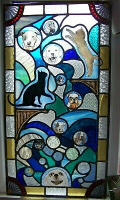 large stained glass panel with cats and dogs