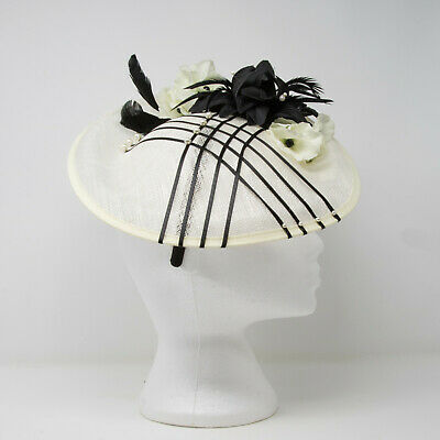 Ivory and black feather hatinator style fascinator on clip, comb and Alice band
