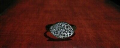 An ancient Slavic ring amulet with solar symbols of the constellation, 12-14 cen