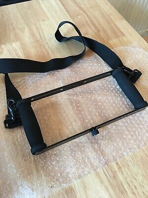 Simple black rectangular frame rig with strap for small cameras