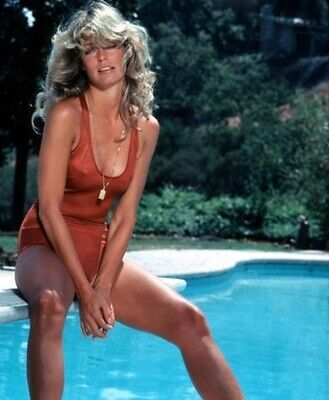 Farrah Fawcett - In A Red One Piece Sitting On The Edge Of A Pool !!