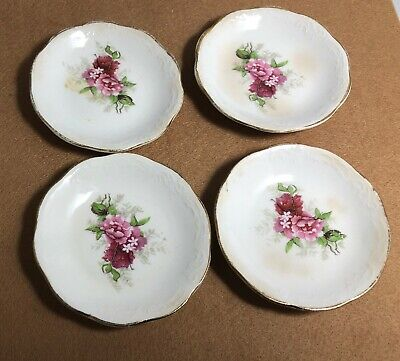 Four Butter Pats with Floral Design and Gold Rim