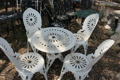 A Vintage 5 Piece White Cast Metal Outdoor Setting - Chairs and Table